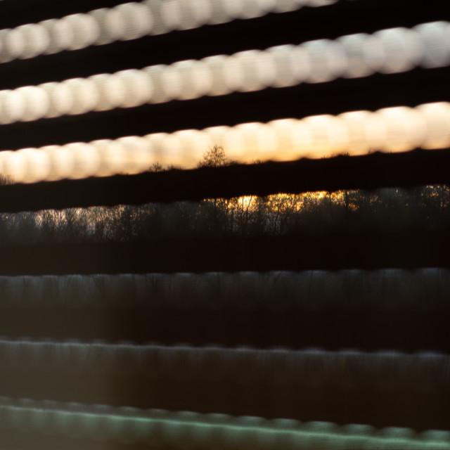 """A sundown through the blinds"" stock image"
