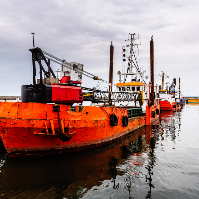 """Old rusty dredge ship moored in the harbour of Sassnitz in Rugen Island"" stock image"