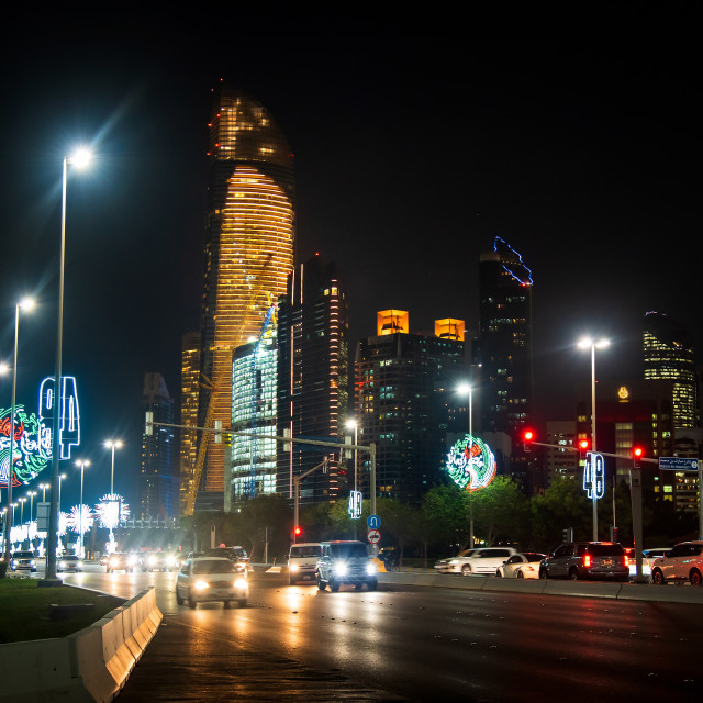 """""""Abu Dhabi Corniche road in the downtown aera at night, long waterfront walking area in the heart of UAE capital"""" stock image"""