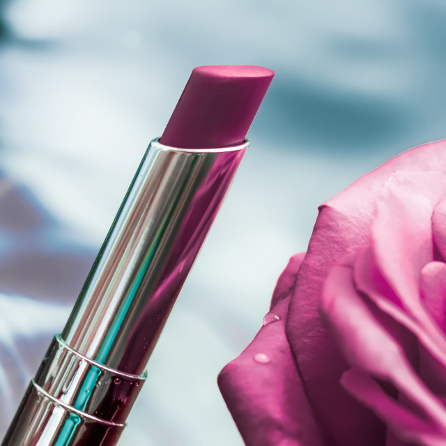 """Purple lipstick and rose flower on liquid background, waterproof glamour..."" stock image"