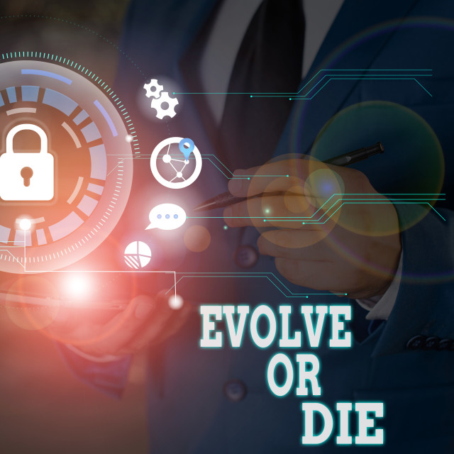 """""""Writing note showing Evolve Or Die. Business photo showcasing Necessity of..."""" stock image"""