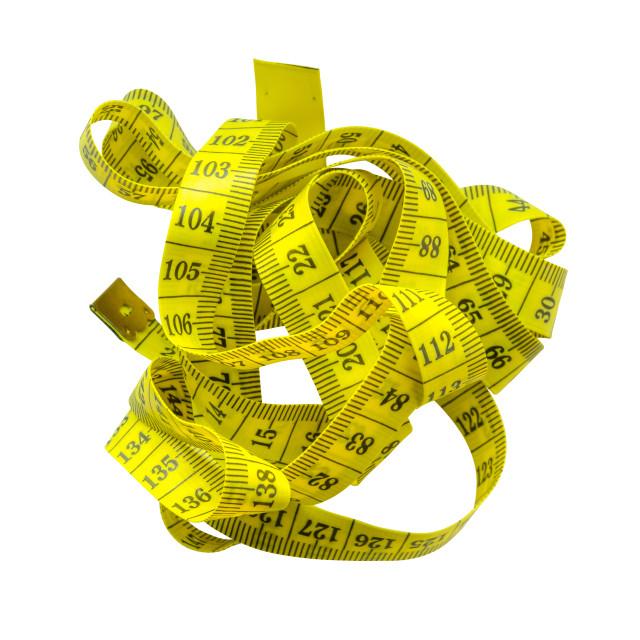 """Tangled Yellow Tape Measure"" stock image"