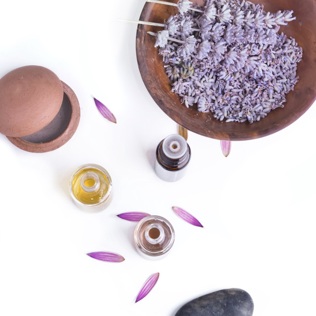 """top view on essentiela oil in bottles and massage balm with lavender on white background"" stock image"