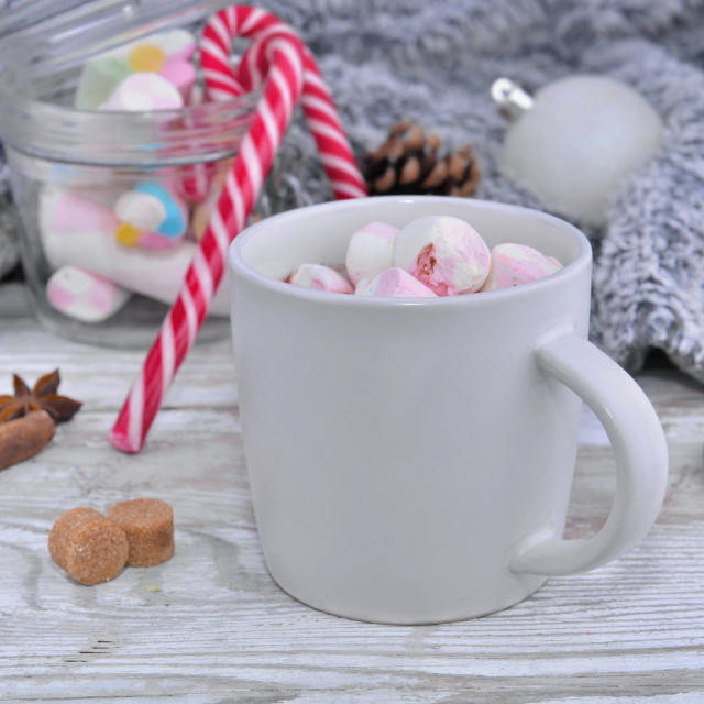 """mug full of marshmallow on a table in christmas decoration"" stock image"