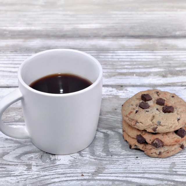"""mug of coffee with cookies on a white table"" stock image"