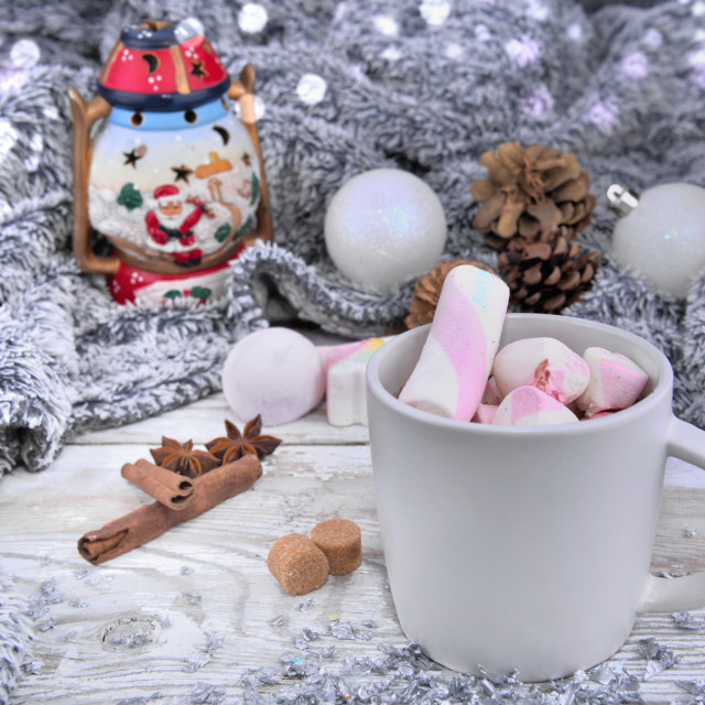 """mug full of mashmallows in milk chocolate front of christmas decor with a warm blanket"" stock image"