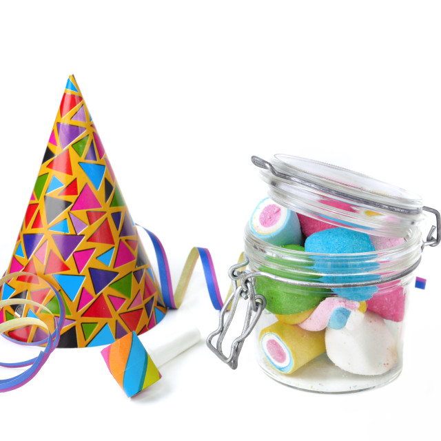 """colorful marshmallows on a glass jar with favors party on white background"" stock image"