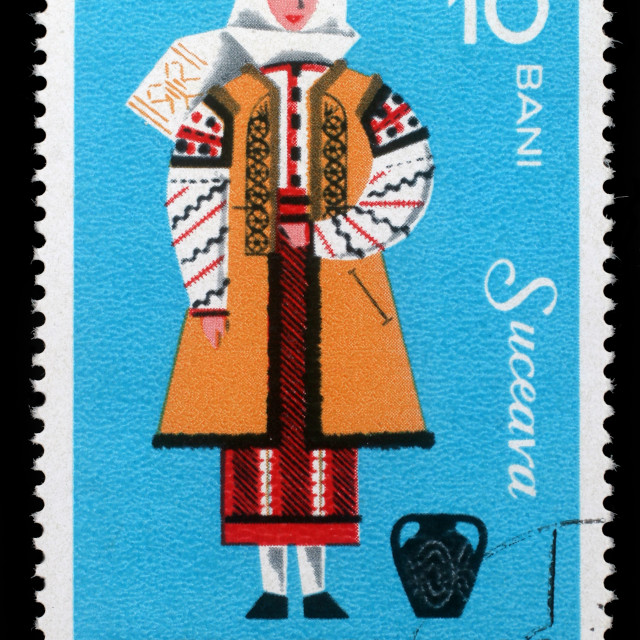 """Stamp printed in Romania shows image of a Suceava woman, from the regional costumes series, circa 1973."" stock image"