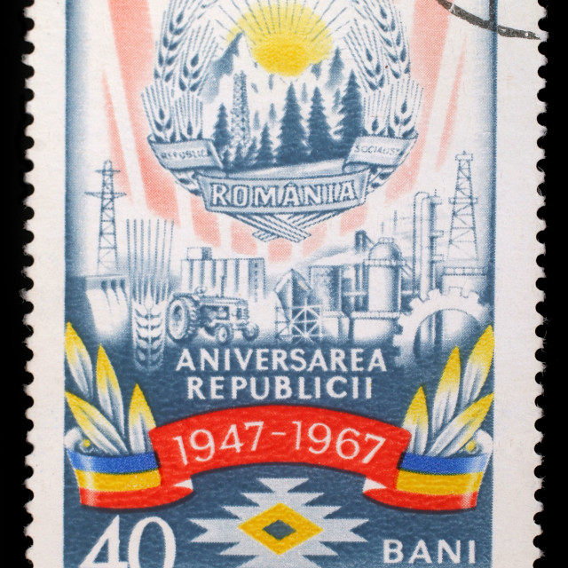 """Stamp from Romania shows image commemorating the 20th anniversary of the Socialist Republic of Romania, circa 1967."" stock image"