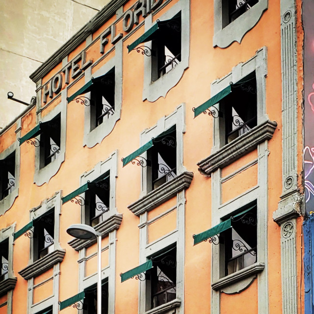 """""""Reflections in windows of the Hotel Florida, el Centro, Mexico City"""" stock image"""