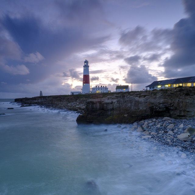 """Portland Bill Light house with a stormy sunset"" stock image"