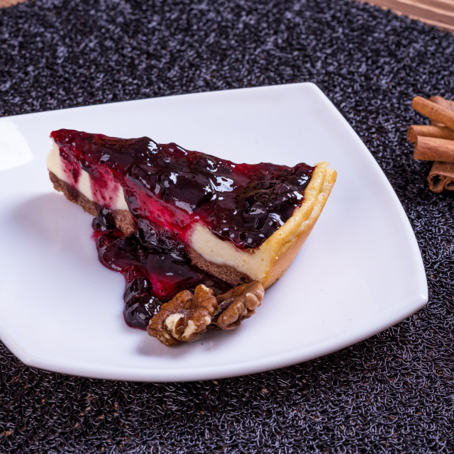 """""""Blueberry cheesecake on wooden table."""" stock image"""