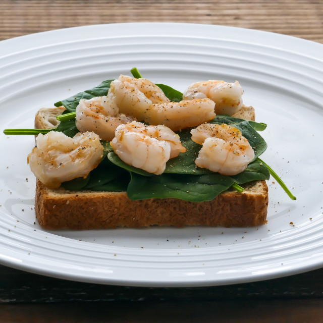 """""""Toast with baby spinach and shrimps on a plate"""" stock image"""