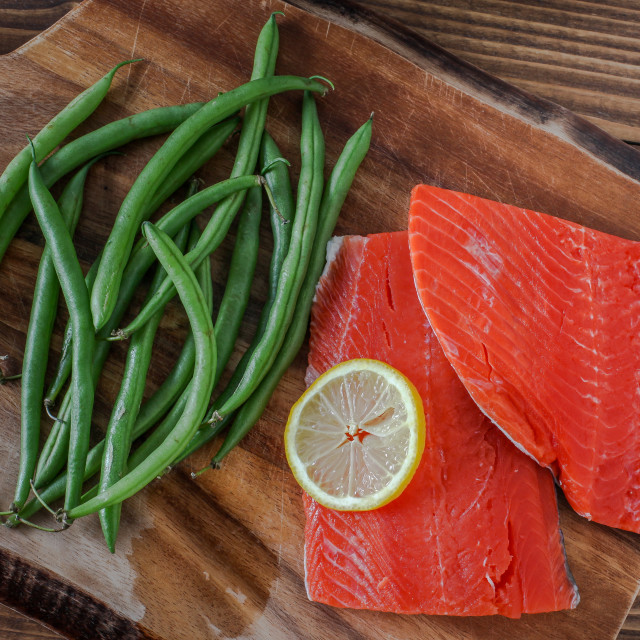 """""""Sock eye salmon with organic green beans and lemon on wooden cut"""" stock image"""