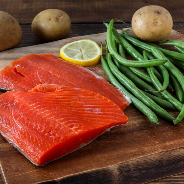 """Sock eye salmon with organic green beans, potatoes and lemon on"" stock image"
