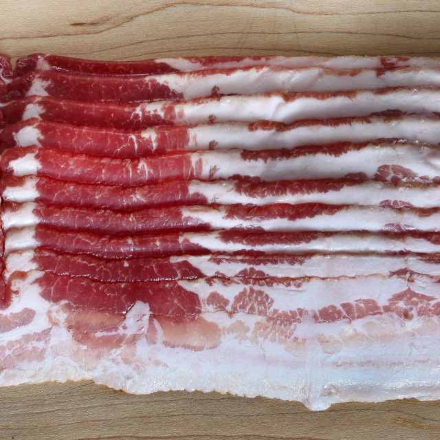 """""""Bacon slices on wooden cutting board"""" stock image"""