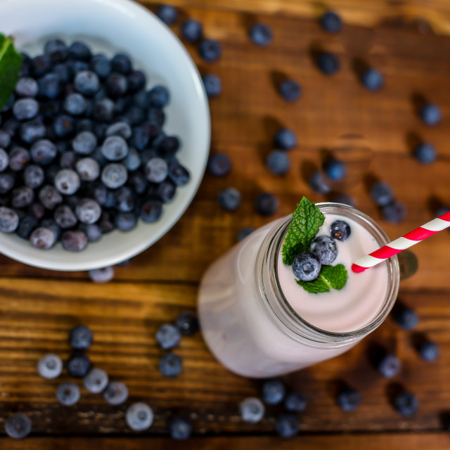 """""""Blueberry smoothie with mint leaf and straw on wooden backround"""" stock image"""