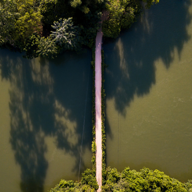 """""""Small bridge over a river aerial view"""" stock image"""