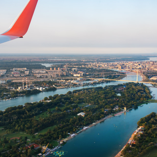 """""""Airplane flying over Belgrade cityscape in Serbia"""" stock image"""