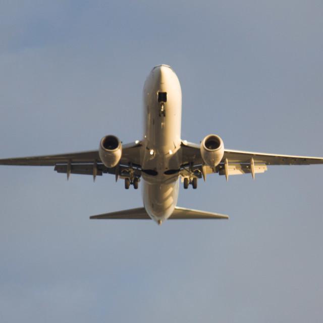 """""""jet airliner descending for landing"""" stock image"""