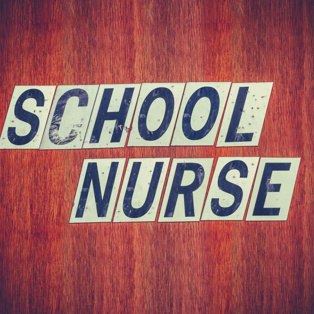 """Grungy School Nurse Sign"" stock image"