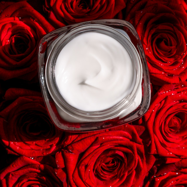 """Moisturizing beauty face cream for sensitive skin and red roses flowers,..."" stock image"