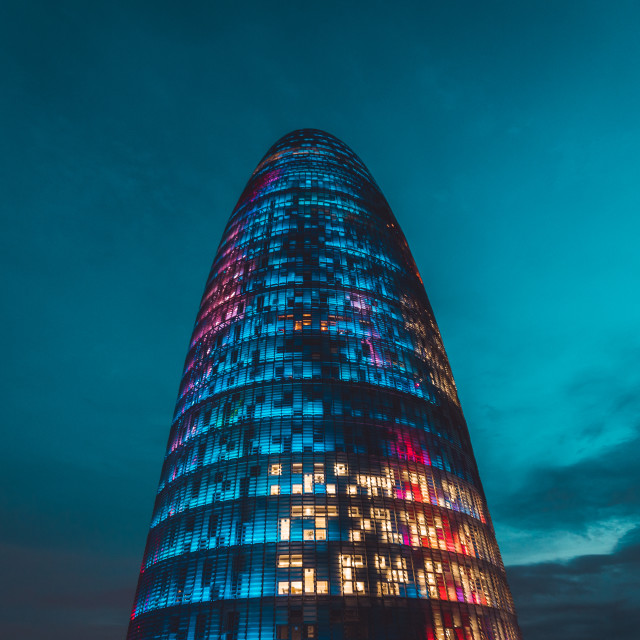 """Agbar Tower (Torre Glories) building exterior at night with lights"" stock image"