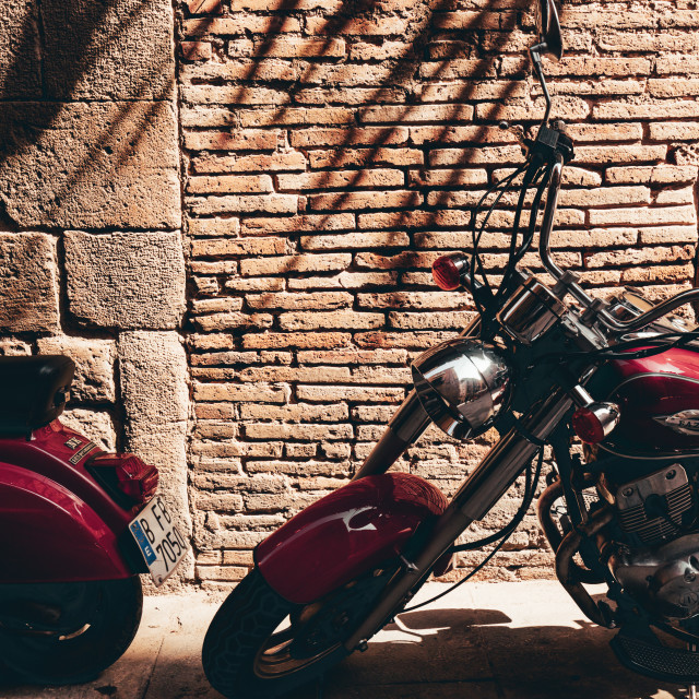 """Scooter motorbike in Gothic Quarter in Barcelona Spain on hot summer day"" stock image"