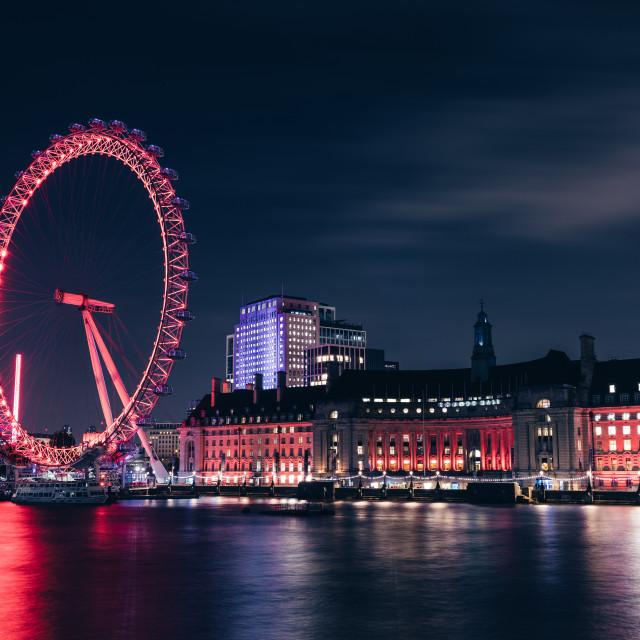 """London eye wheel on modern city skyline at night"" stock image"