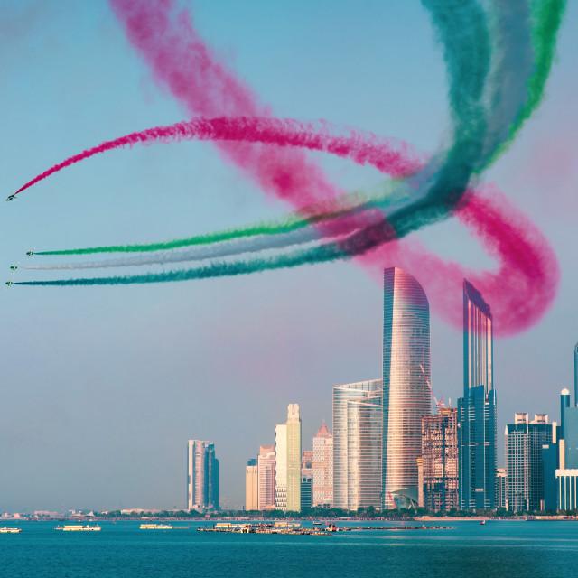 """Airplanes flying above Abu Dhabi skyline for the UAE national da"" stock image"