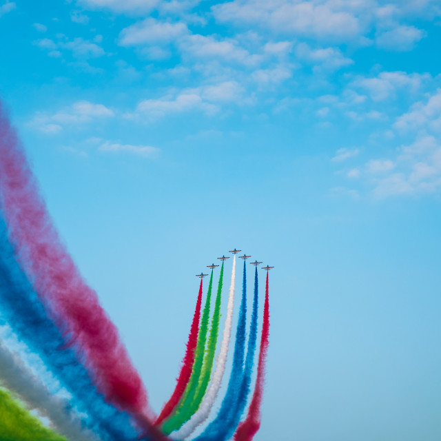 """""""Jet planes leaving colorful trails on the sky during an airshow"""" stock image"""
