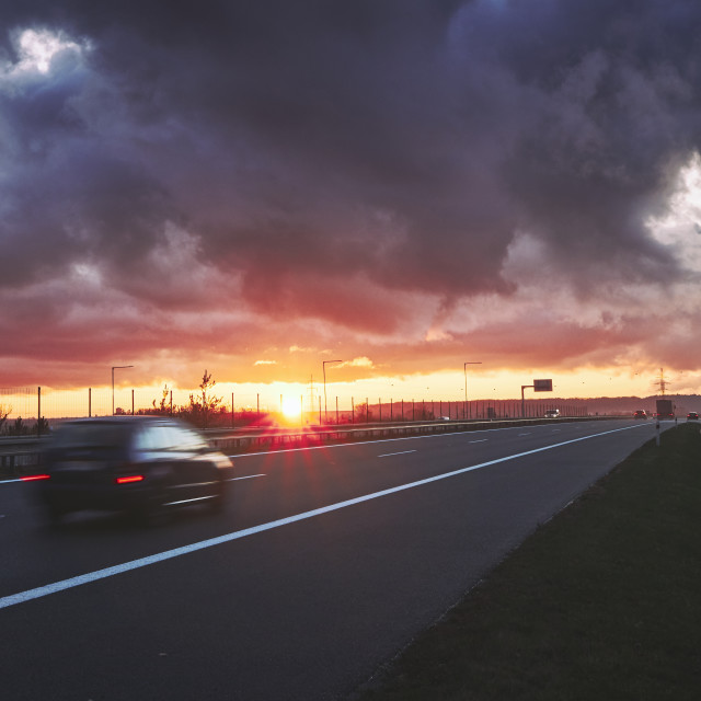 """Highway at sunset"" stock image"