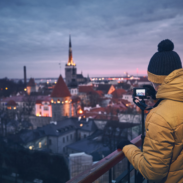 """Photographer at dawn"" stock image"