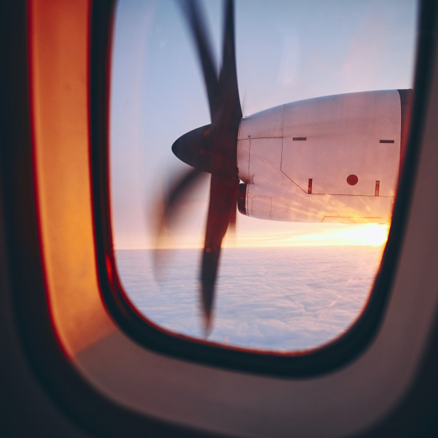 """Propeller airplane during flight above clouds"" stock image"