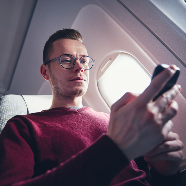 """Internet connection during flight"" stock image"