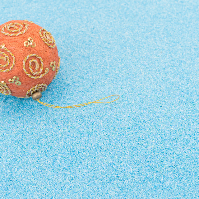 """Christmas baubles decors on a turquoise sand background"" stock image"