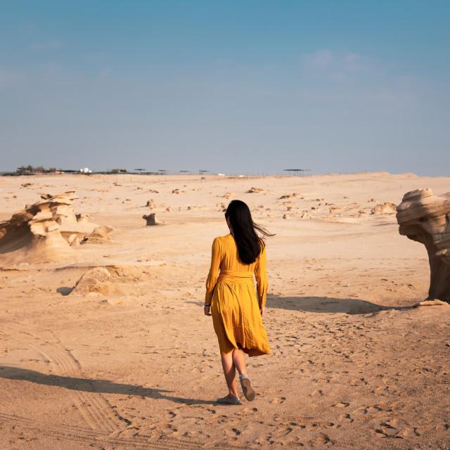 """Female traveler visiting Fossil dunes in Abu Dhabi UAE"" stock image"