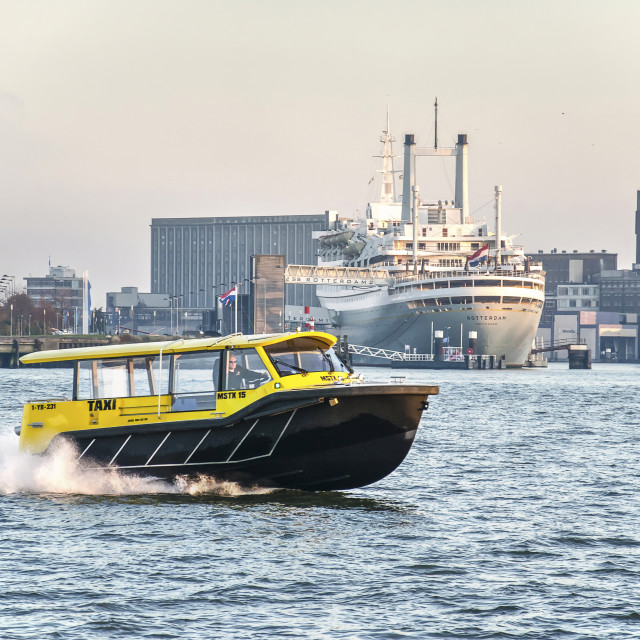 """Watertaxi and historic cruiseship"" stock image"