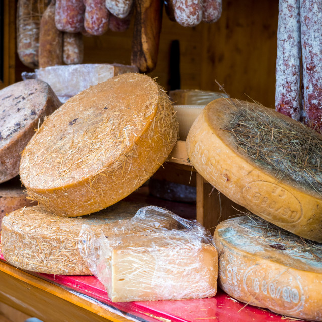 """""""cheese wheels on open air market stall"""" stock image"""