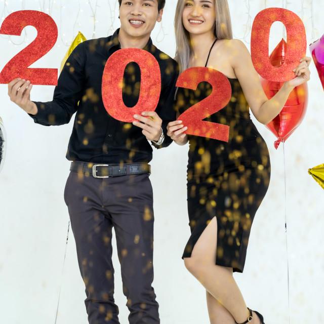 """Couple celebrate 2020 party"" stock image"