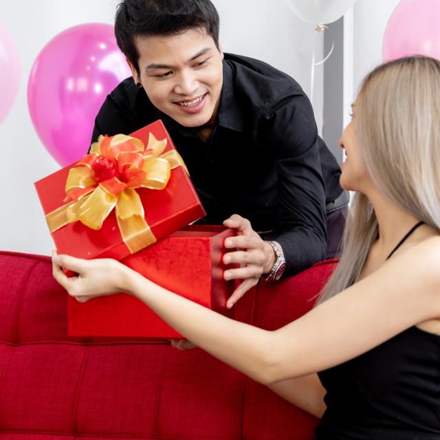 """Couple oping gift box"" stock image"