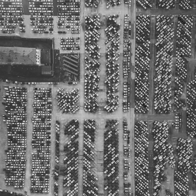 """""""Overhead downward aerial view of parking congestion and crowded parking lot"""" stock image"""