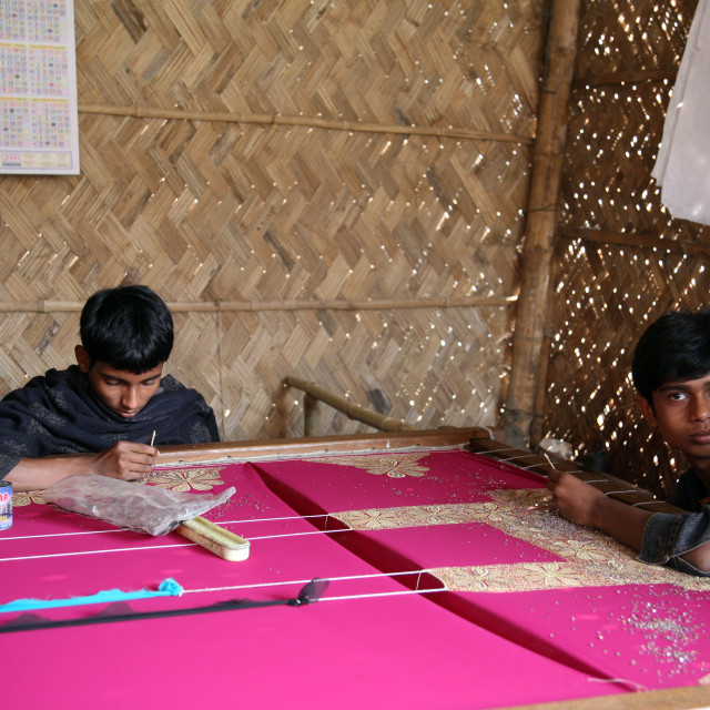 """Child workers working on the decoration of textiles in Kumrokhali, India"" stock image"