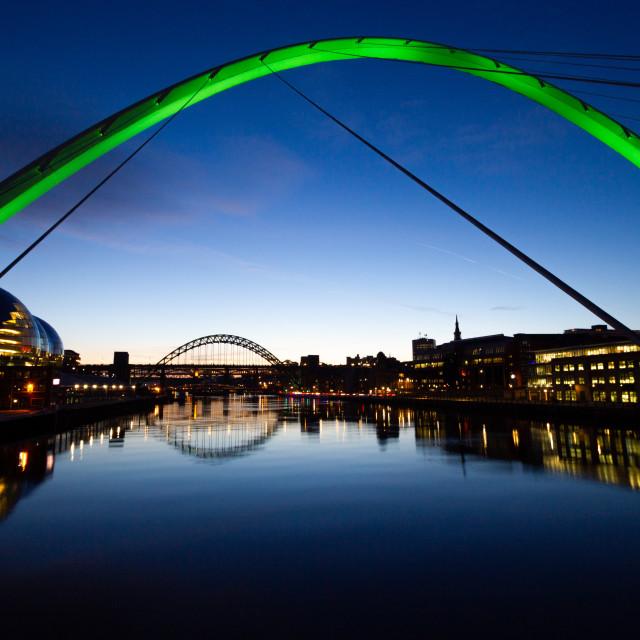 """Gateshead Millennium Bridge at dusk (green light)"" stock image"
