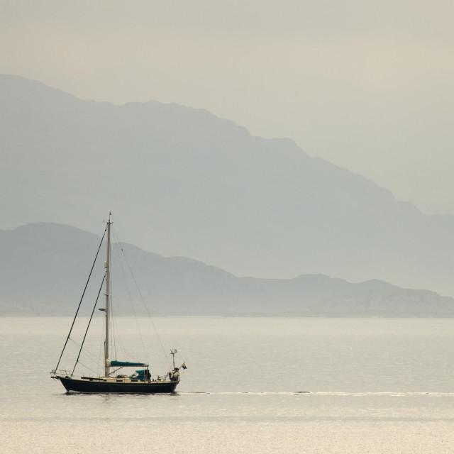 """Yacht sailing on misty shores"" stock image"