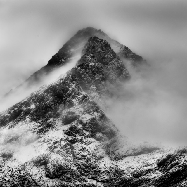 """Mountain peak in snow and cloud"" stock image"