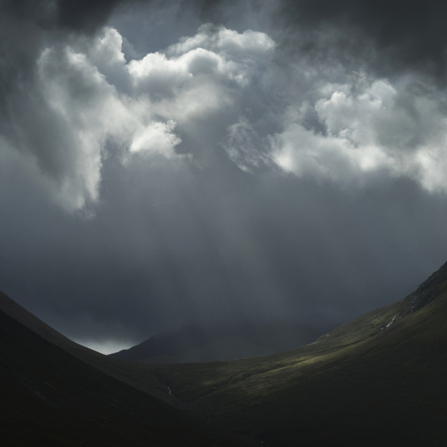"""Stormy sky and light rays"" stock image"