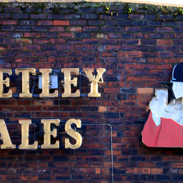 """""""Very old Tetley Brewery sign, Leeds."""" stock image"""