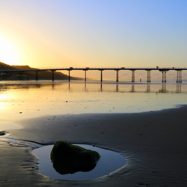 """Saltburn beach and pier at sunset."" stock image"
