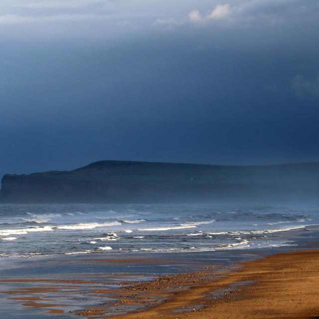 """Stormy sky over Huntcliff, Saltburn."" stock image"